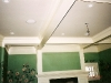 custom fireplace and coffered ceiling